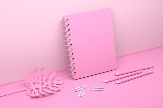 Różowa kompozycja z pustym notatnikiem spiralnym i liściem rośliny monstera