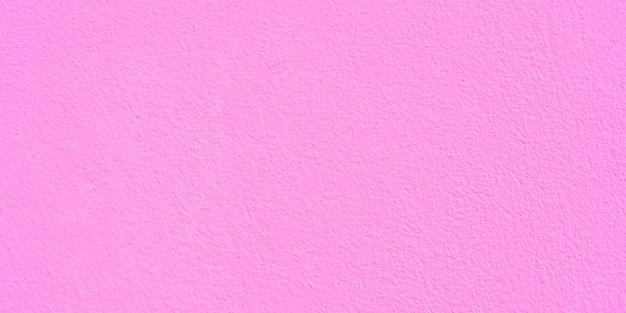 Różowa tekstura ściany cementu na tle i kopia miejsce na tekst. różowe tło papieru.