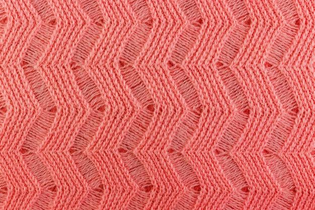 Różowa wełna dzianiny tekstura zbliżenie. tło naturalne tkaniny wełniane