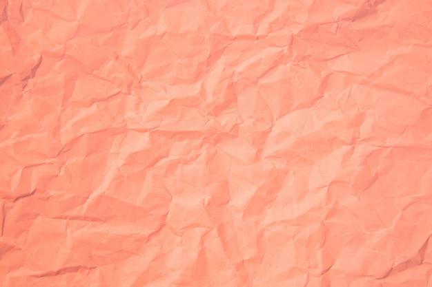 Różowa zmarszczka zmięty stary z szorstkim tle strony papieru tekstury. zagniecenie grunge pergamin wzór vintage