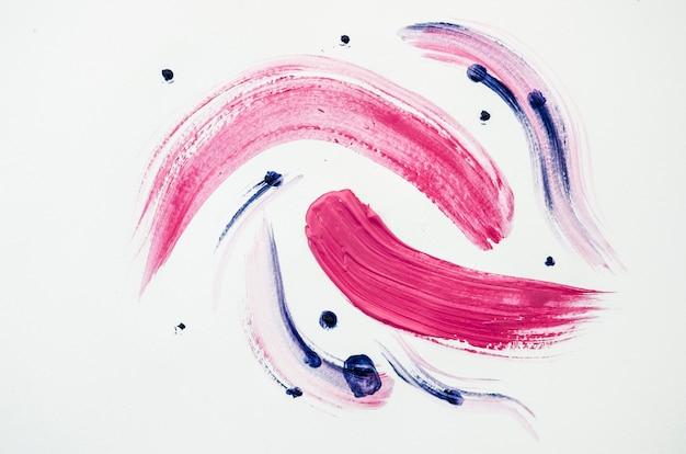 Różowe linie na białym płótnie