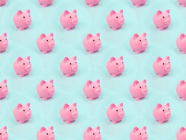 Różowe skarbonki wzór na niebieskim tle. koncepcja oszczędzania pieniędzy, oszczędności.