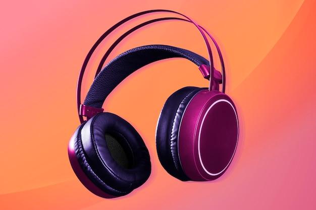 Różowe słuchawki bezprzewodowe urządzenie cyfrowe
