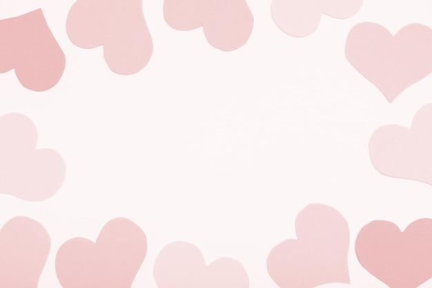 Różowe tło papieru, ramka z serca, kopia przestrzeń.