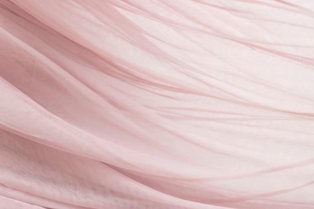 Różowe tło tekstury tkaniny szyfonowej