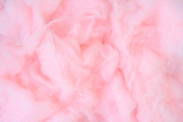 Różowe tło waty, streszczenie puszysty miękki kolor tekstury słodkiej waty cukrowej