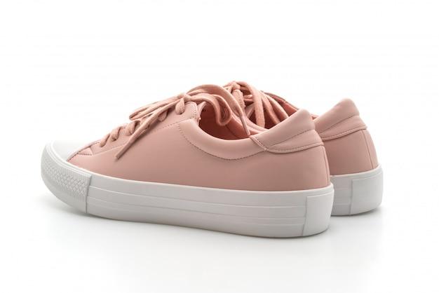 Różowe trampki buty na białym tle