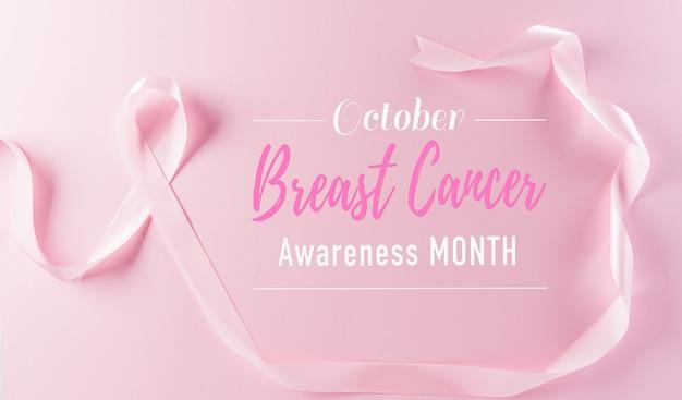 Różowe wstążki na pastelowym tle symbol świadomości raka piersi u kobiet