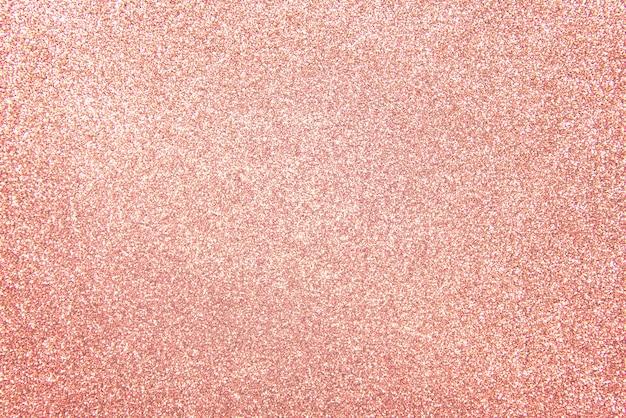 Różowe złoto - jasny i różowy szampański blask brokatowy wzór tła