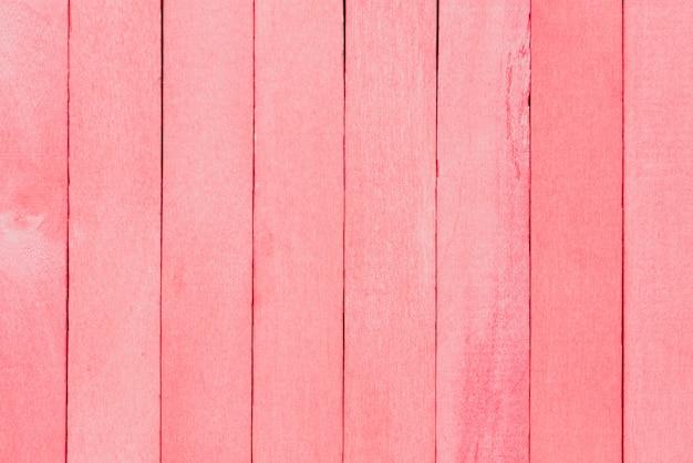 Różowego pastelowego koloru tekstury drewniany tło