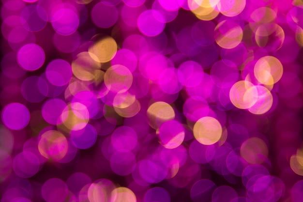 Różowi abstrakcjonistyczni bokeh światła. kolorowy. niewyraźne tło.