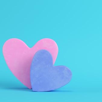 Różowy i niebieski abstrakcyjny kształt serca na jasnoniebieskim