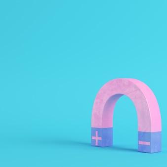 Różowy magnes na jasnoniebieskim tle