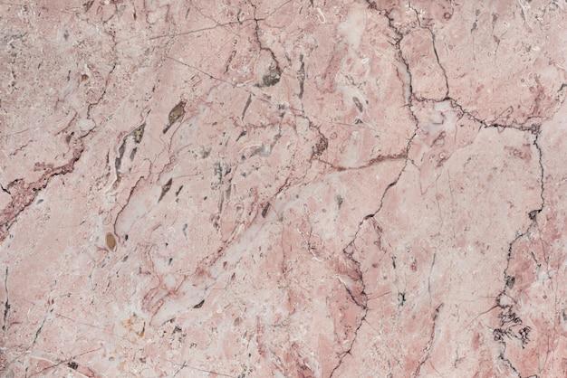 Różowy marmurowy teksturowany wzór tła