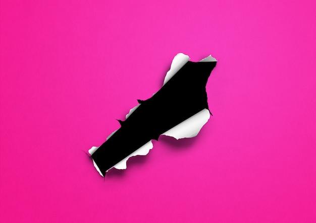 Różowy rozdarty papier z czarną dziurą