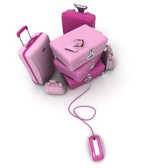 Różowy stos bagażu podłączony do myszy komputerowej.