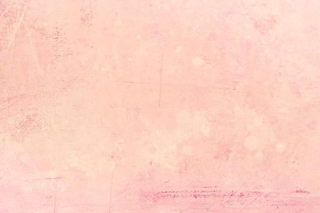 Różowy teksturowanej stiuk ściany tło
