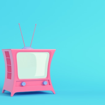 Różowy telewizor w stylu kreskówek na jasnoniebieskim w pastelowych kolorach