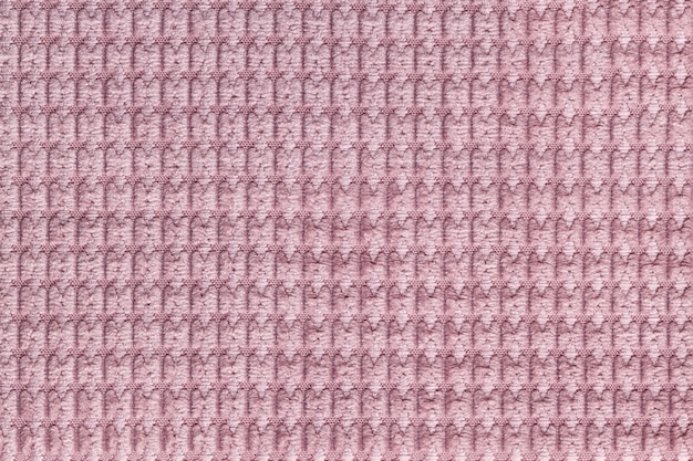 Różowy tło z miękkiej wełnianej tkaniny z bliska. tekstura tekstylne makro