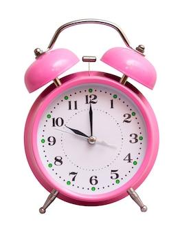 Różowy zegar na białym tle pokazuje 10 godzin