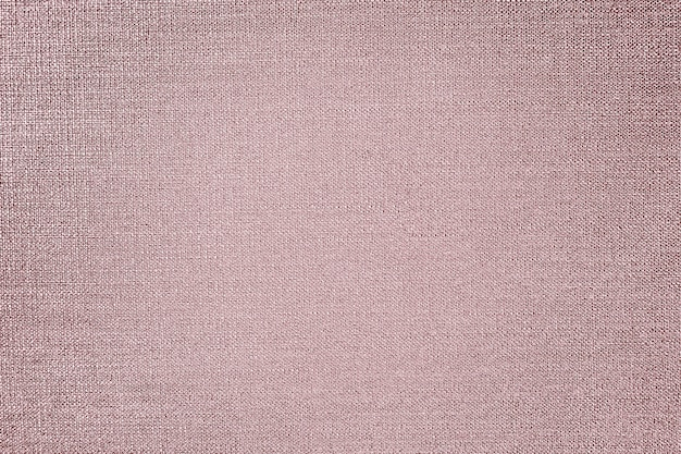 Różowy złoty bawełniany materiał teksturowany w tle