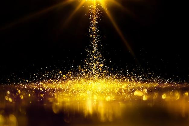 Rozpryski złotego brokatu to oświetlenie bokeh