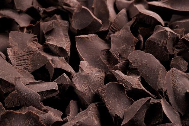 Rozsypisko łamana gorzka czekolada, deserowy karmowy tło
