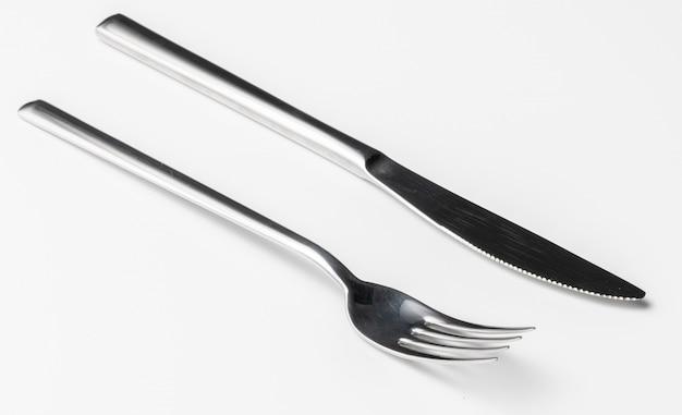 Rozwidlenie i nóż odizolowywający na białym tle