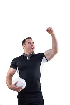 Rugby gracz dopingujący z piłką