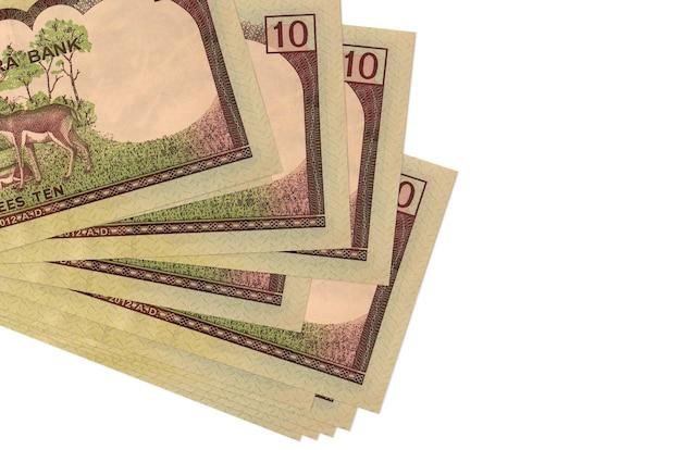 Rupie nepalskie rachunki r. w mały pęczek lub paczkę na białej powierzchni
