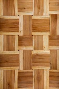 Rustykalna tekstura wikliny (kosz). linie poziome i pionowe. ochry i brązowe odcienie.
