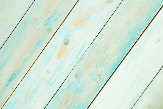 Rustykalne, turkusowe, niebieskie deski drewniane po przekątnej