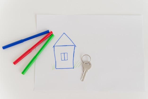 Rysunek domu i klucza na białej przestrzeni