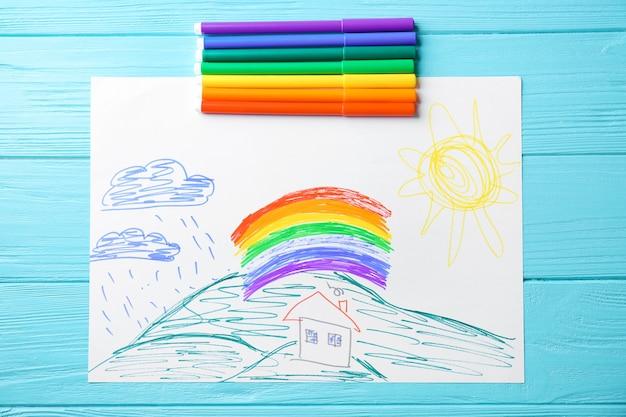 Rysunek dziecka przedstawiający dom i tęczę