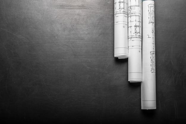 Rysunki planowania budowy na czarnym tle