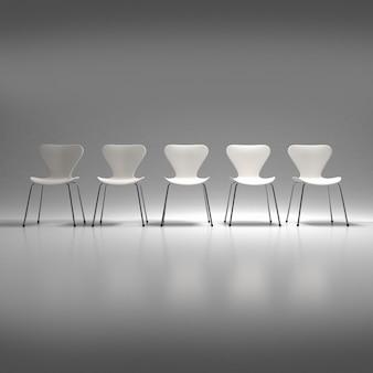 Rząd pięciu białych plastikowych i metalowych krzeseł na neutralnym tle