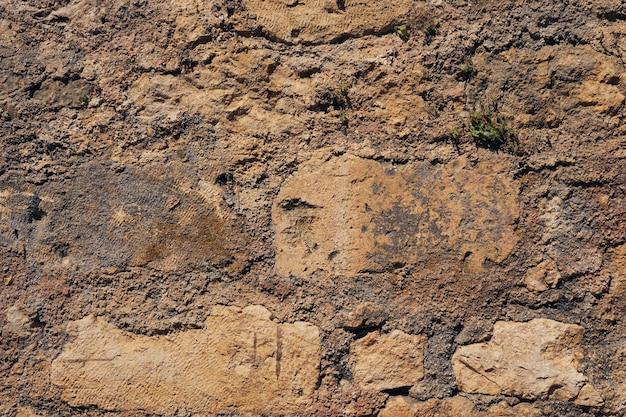 Rzadka ściana vintage na krecie w grecji jako naturalne tło.