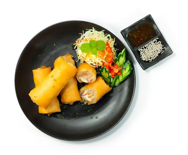 Sajgonki smażone w głębokim tłuszczu danie zakąskowe asianfood udekoruj rzeźbione warzywa styl widok z góry