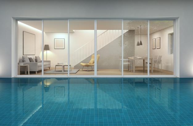 Salon, jadalnia i basen w nowoczesnym domu.
