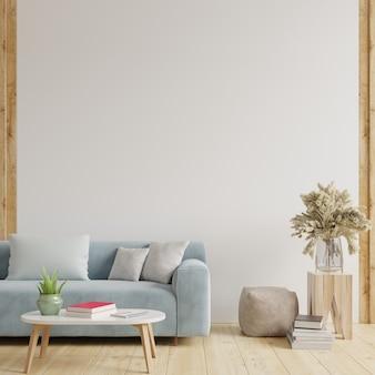 Salon z białymi ścianami ma sofę i dekoracje