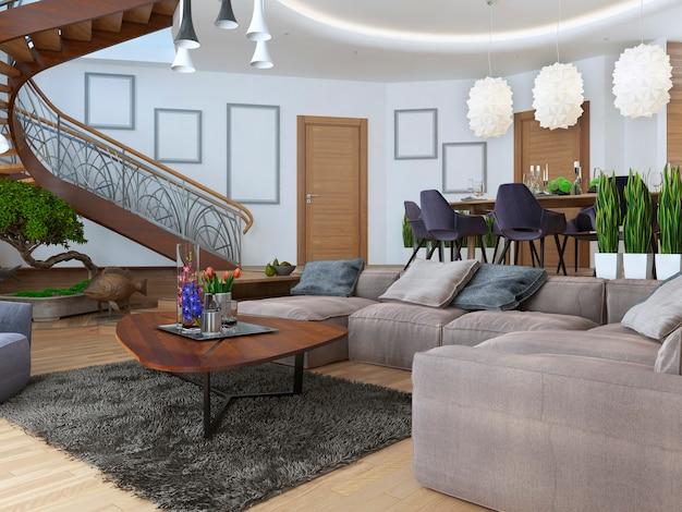 Salon z dużym narożnikiem z tkaniny w stylu współczesnym ze spiralnymi schodami prowadzącymi na piętro.