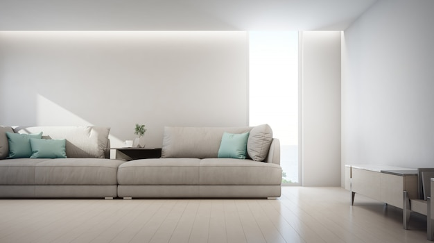 Salon z widokiem na morze luksusowego letniego domu na plaży ze stolikiem telewizyjnym i drewnianą szafką w pobliżu dużej sofy.