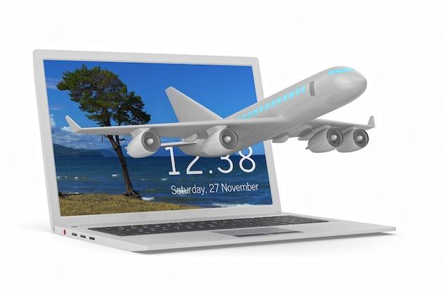 Samolot i laptop na białym tle