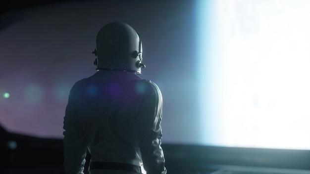 Samotny astronauta patrzący na ogromny iluminator nieznanego wnętrza statku kosmicznego. renderowania 3d.
