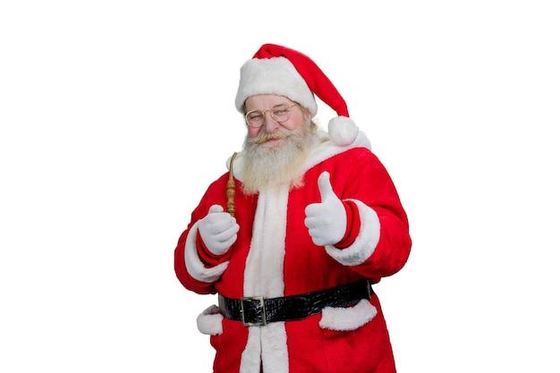 Santa z fajką daje kciukowi up.