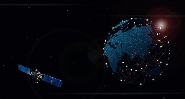 Satelita unoszący się w kosmosie nad ziemią koncepcja połączenia bezprzewodowego sieć 5g internet na szybkim telefonie