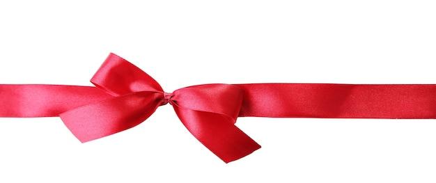 Satynowa kokardka w kolorze prezentu, na białym tle