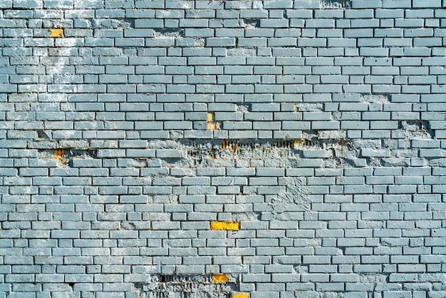 Ściana budynku z niebieskiej cegły. wnętrze nowoczesnego loftu. tło