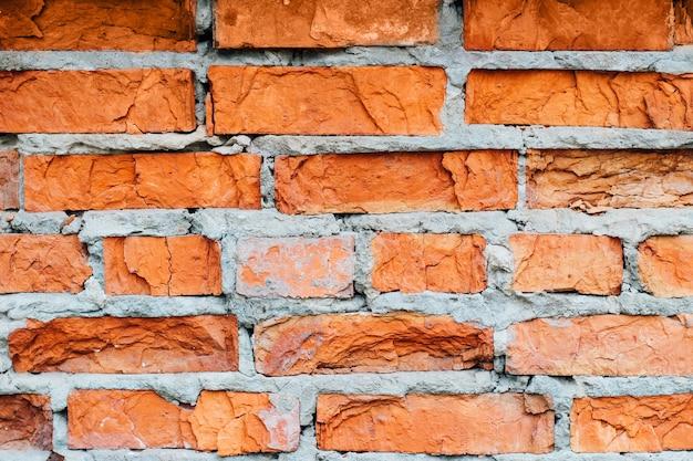 Ściana domu ze starej czerwonej cegły. tekstury i tła