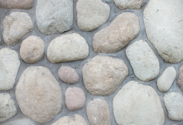 Ściana okrągła kamiennego kamienia tekstury przestrzeni. duże kamienie na jezdni.